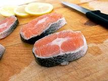 Stakes of salmon on board Royalty Free Stock Image