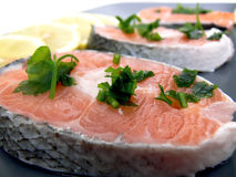 Stakes of salmon on plate Royalty Free Stock Photos