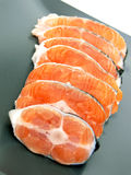 Stakes of salmon on plate Stock Image