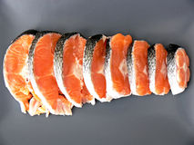 Stakes of salmon on plate. Close up of the fresh stakes of salmon on dark plate Stock Photo