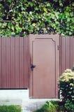 Staket och en dörr Fotografering för Bildbyråer