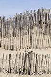 Staket på stranden arkivbild