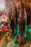 Stalactite stalactites with color lighting. In cave royalty free stock image