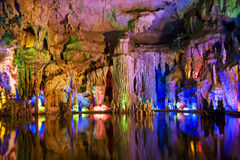Stalactite and Stalagmite Formations. Image of stalactite and stalagmite formations all lighted up at Assembly Dragon Cave, Yangshuo, Guilin, China Royalty Free Stock Image