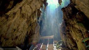 KUALA LUMPUR, MALAYSIA - May 15, 2018: Tourist and stalactites in Batu cave at Kuala Lumpur, Malaysia. 4K