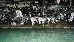 Stalactites at the foot of islands in the ocean. Stalactites at the foot of islands in the ocean stock video
