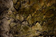 Stalactites in lime stone cave growing from sealing royalty free stock photo