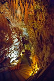 Stalactites and stalagmites in a cave stock image