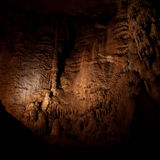 Stalactites and stalagmites in a cave Stock Photo