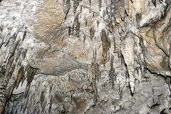Stalactites and stalagmites in karst caves. Stalactites and stalagmites in karstic caves . Russia royalty free stock photo