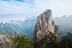 The stalagmite peak in sea of clouds Stock Photos
