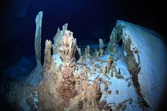 Stalagmites of cenote underwater cave Stock Photos