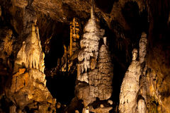 Stalagmites and flowstones in a cave Royalty Free Stock Photos