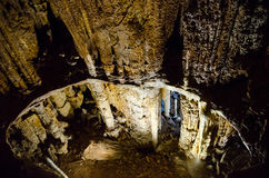 Stalagnates. Cave Emine Bair Khosar in Crimea. Stalagnates. Karst cave Emine Bair Khosar in Crimea. Massif Chatyrdag-Yayla. Vicinity of Alushta. Near the Stock Photos
