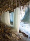 Stalagnates of ice are in a cave Royalty Free Stock Images