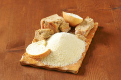 Stale bread and finely ground breadcrumbs Royalty Free Stock Photography