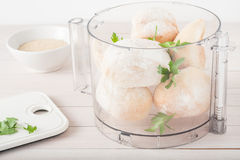 Stale rolls with fresh parsley in food processor Stock Photos