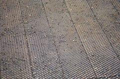 Stali sieć na drewnianej podłoga Zdjęcia Stock