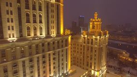 Stalin high rise Symbol of soviet Moscow Russia. Modern luxury hotel Ukraine Downtown. Business district skyscrapers. Winter snow. Winter snow and ice river stock video footage