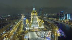 Stalin high rise Symbol of soviet Moscow Russia. Modern luxury hotel Ukraine Downtown. Business skyscrapers. Winter snow and ice. Winter snow and ice river stock footage