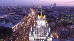 Stalinist high rise building at Mayakovskaya square in Moscow. Beautiful night illumination. Road traffic. Aerial drone flight. 4K footage stock video