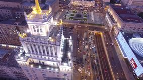 Stalinist high rise building at Mayakovskaya square in Moscow. Beautiful night illumination. Road traffic. Aerial drone flight. 4K footage stock video footage