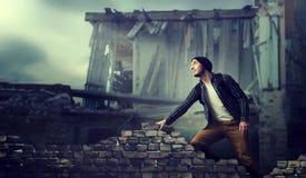 Stalker, alone traveler on ruins of abandoned city. Stalker, alone traveler on the ruins of the abandoned city. Danger zone, post apocalypse horror Stock Photo