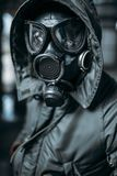 Stalker in gas mask, radiation danger. Stalker concept, male person in gas mask, radiation danger. Post apocalyptic lifestyle, doomsday, horror of nuclear war royalty free stock image