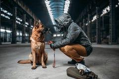 Stalker and dog, survivors in danger zone Stock Images