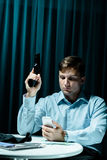Stalker with gun and phone Royalty Free Stock Image