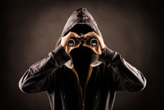 Stalker. Picture of a faceless person with a spyglass royalty free stock photo