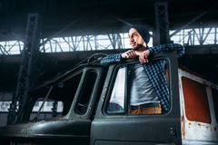 Stalker pose on abandoned military vehicle. Stalker, alone traveler pose on abandoned military vehicle. Danger zone, mysterious adventure in deserted place Stock Image