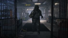 Stalker runs along an abandoned subway. The concept of a post-apocalyptic world after a nuclear war.