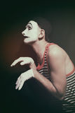 Stalking actor mime on a black background Royalty Free Stock Image