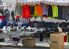 Stall with clothes and caps Stock Photo