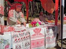 Stall with handicraft rushnyks and crocheted items Stock Photography