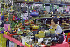 Stall holders selling gardening supplies such as pots Stock Photo