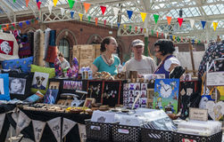 Stall holders and shoppers at Tynemouth Market. Stock Photo