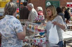 Stall holders and shoppers at Tynemouth Market. Stock Photos