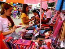 Stall owner selling assorted wallets in taytay, rizal, philippines Stock Photos