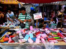 Stall owner selling assorted wallets in taytay, rizal, philippines Stock Photo