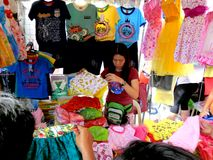 Stall owner selling clothes in taytay, rizal, philippines Royalty Free Stock Images