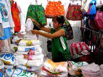 Stall owner selling clothes in taytay, rizal, philippines Royalty Free Stock Photos