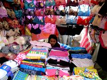 Stall owner selling underwear and lingerie Royalty Free Stock Images