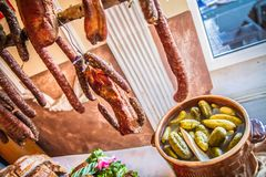 Sausages and cold cuts and brined pickles stock photo
