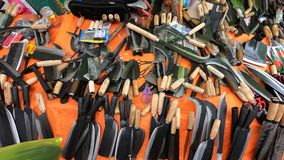 The stall sells knives and scissors during a festival stock photo