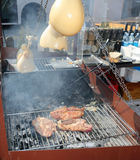 Stall Southern Italy with baked cheese over the hot coals alfres Royalty Free Stock Images