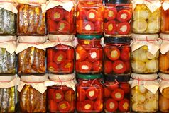 Stall southern Italy with pots of peppers and anchovies Stock Images