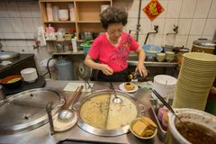 Stall vendor woman prepares taiwanese noodles for sale at her stall royalty free stock photos