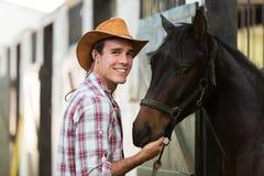 Stalla del cavallo del cowboy Immagini Stock